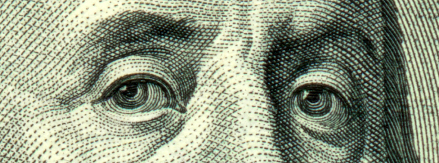 Closeup of Benjamin Franklin's portrait on the 100-dollar bill