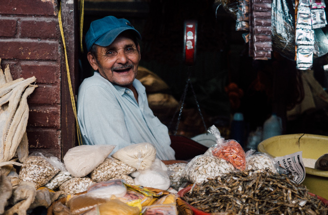 happy old market stall seller